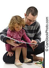 Dad and Daughter - An young dad reading fairy tales to his...
