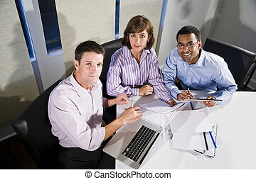 Multi-ethnic office workers working on project - Workplace...