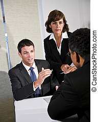 Business negotiation - Mid-adult businessman and...