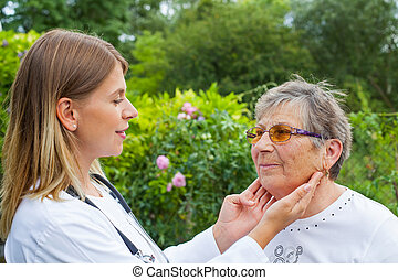 Doctor examining sore throat