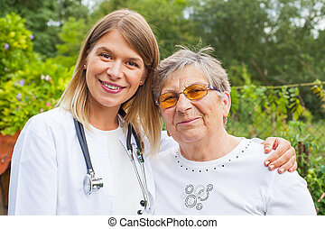 Elderly woman with female doctor