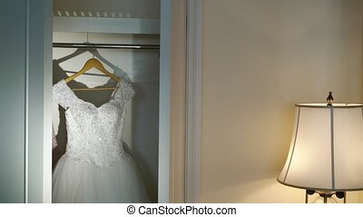Wedding dress in wardrobe - Wedding white dress in wardrobe