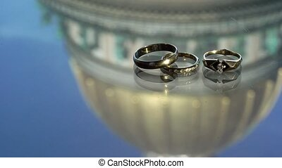 Three wedding rings with reflection of cathedral