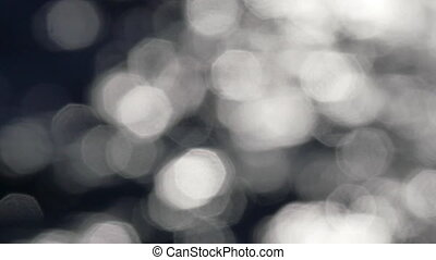 Slow motion of bright sparkling water in darkness. Slow...