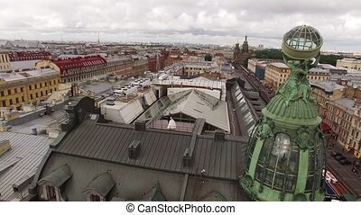 Bride and groom on a roof in a city