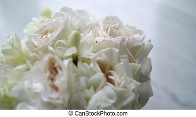 Bridal bouquet on marble background