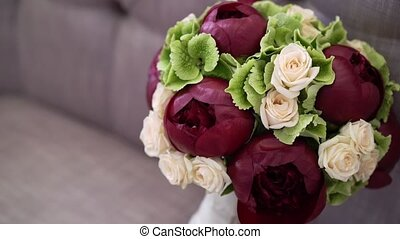 Bridal bouquet on sofa - Bridal bouquet with red peonies on...