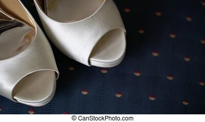 Wedding bridal shoes on blue chair