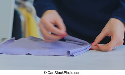 Professional fashion designer working at sewing studio