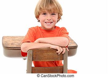 School Boy in Desk - Adorable 7 year old school boy in desk...