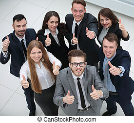 triumphant business team raised a thumbs up - concept of...