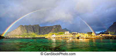 Lofoten fishing village with rainbow - Rainbow over Reine...