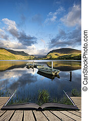 Stunning dramatic stormy sky formations over breathtaking mountain lake landscape with rowing boats in foreground concept coming out of pages in book