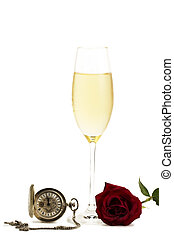 cold glass with champagne with a red rose and a old pocket watch on white background