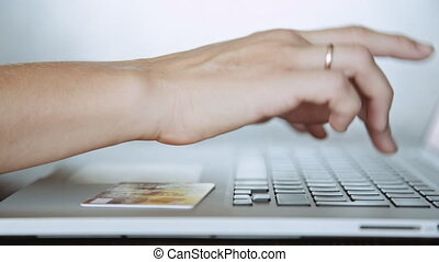 Paying with a credit card online, shopping - Side view...
