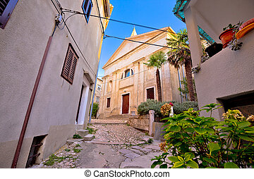 Old adriatic town Vrbnik stone street and church view,...
