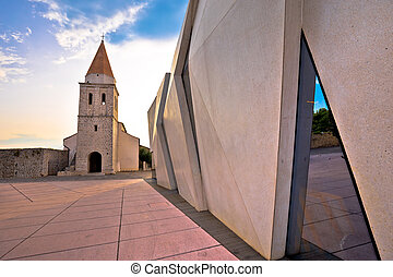 Town of Krk historic square church and modern architecture...