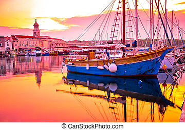 Historic island town of Krk golden dawn waterfront view,...
