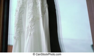 White wedding dress on terrace