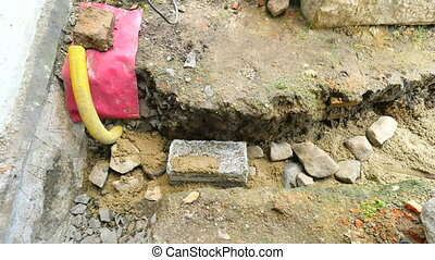 Pouring, laying concrete into foundations of the house using...