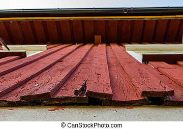 Painted old wooden wall needs rehabilitation - Red painted...
