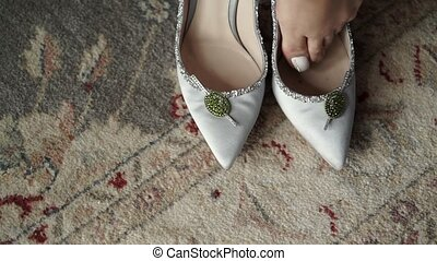 Young woman dressing shoes indoors