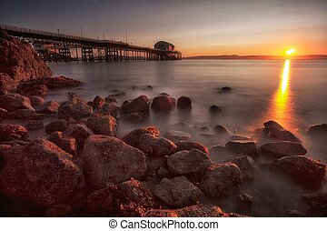 Sunrise at Mumbles pier - A calm morning at Mumbles Pier,...