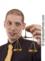business man - A business man holding a justice scale,...