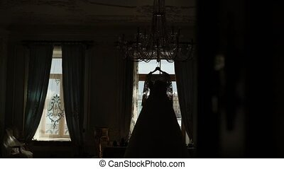 Wedding dress silhouette on a window