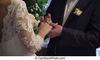 Bride and groom exchanging wedding rings on ceremony