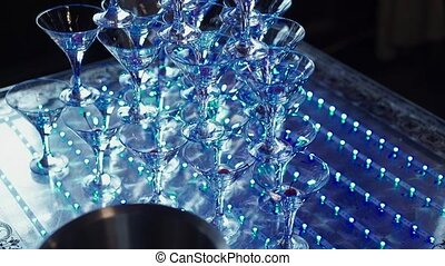 Pyramid of glasses with champagne with led light