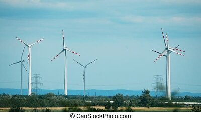 Wind generators and electric power pylons