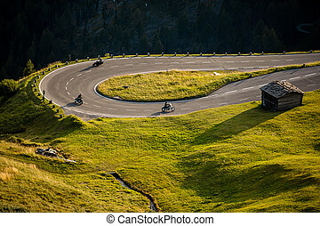 Motorcycle drivers riding in Alpine highway on famous...