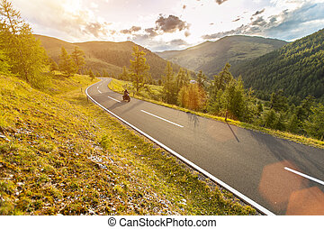 Motorcycle driver riding in Alpine highway, Nockalmstrasse,...