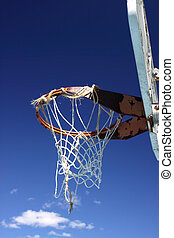 Well used basketball hoop - An old basketball hoop and net...