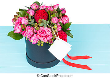 Close up of gallant bouquet of pink and red roses with a...