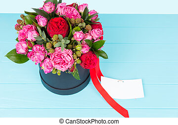 View from above on lovely bouquet of pink and red roses with...