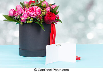 Lovely bouquet of pink and red roses with a blank gift tag...