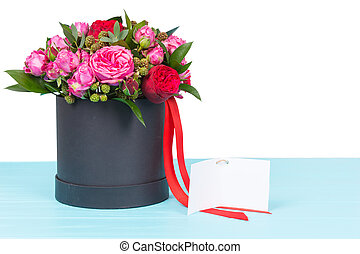 Beautiful bouquet of pink and red roses with a blank gift...