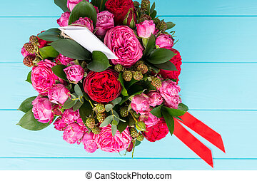 View from above on beautiful bouquet of pink and red roses...