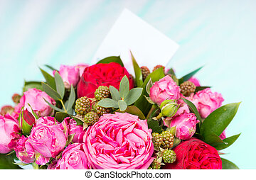 Close up of stylish bouquet of pink and red roses with a...