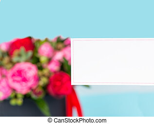 Blank gift tag with copy space, bouquet of pink and red...
