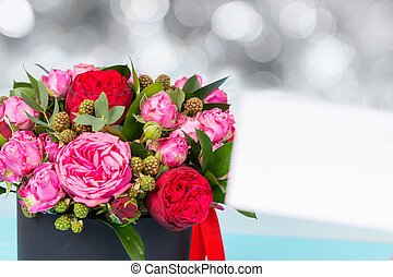 Beautiful bouquet of pink and red roses, blank gift tag with...