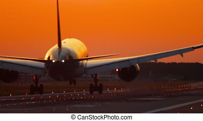 Airplane landing at the early morning - The wide-bodied...