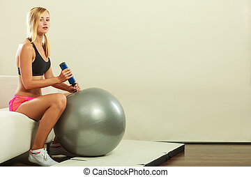 Fitness woman with air pump inflating fit ball - Sport,...