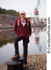 Tourist in Turku, Finland - Tourist with backpack standing...