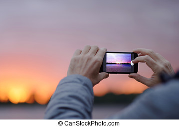 Man takes picture with mobile phone