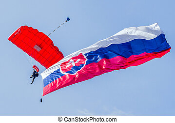 Parachuter with slovak flag - Parachuter with waving slovak...