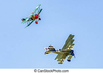 Dogfight between biplane and triplane at airshow SIAF