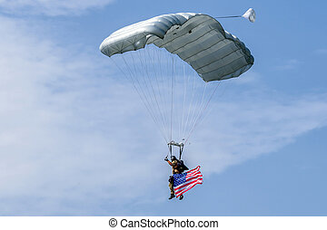 Parachuter with american flag - Parachuter with waving...